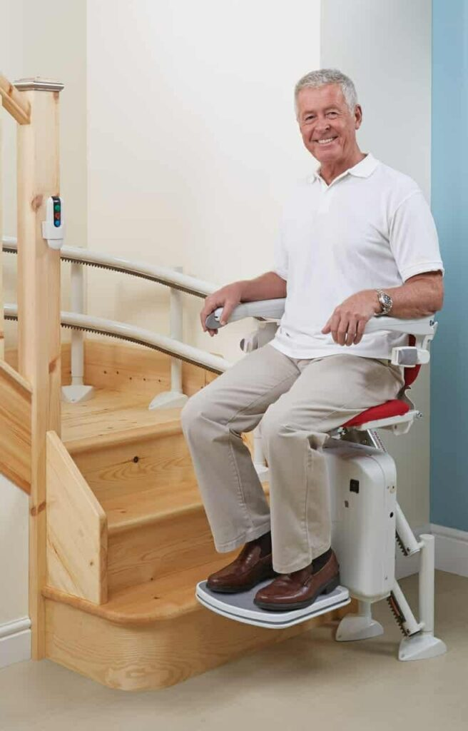 Customer using a Handicare curved stairlift