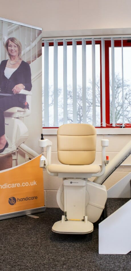Handicare curved stairlift on display at the Surrey Stairlifts showroom